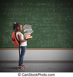 Pile of math books for a child - Child with backpack and a...