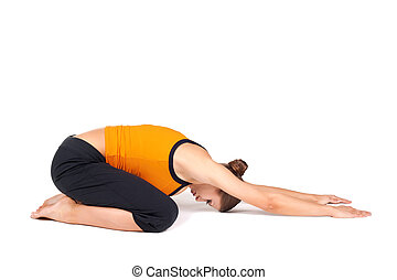 Woman Doing Extended Child Pose Yoga Asana - Fit woman doing...