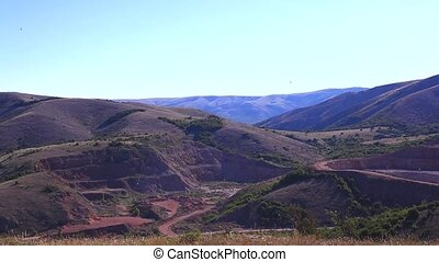 Quarry red marble. - Panorama shooting. Quarry mining red...