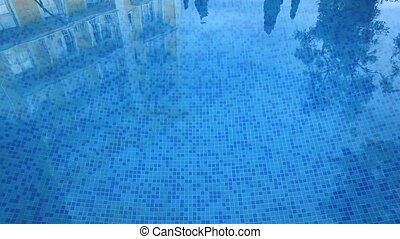Swimming pool at hotel - The pool water is reflected hotel...