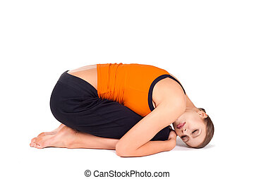 Woman doing Yoga Relaxing Exercise - Young woman doing...
