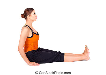 Woman Practicing Staff Pose Yoga Asana - Fit woman doing...