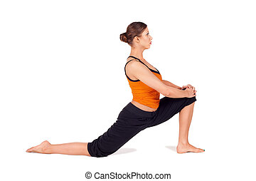Fit Attractive Woman Practicing Yoga Stretching Pose - Woman...