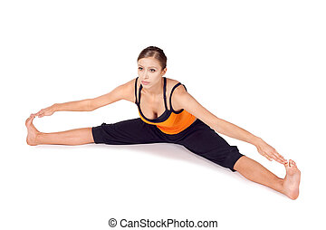 Fit Young Woman Practicing Yoga Asana - Woman doing first...