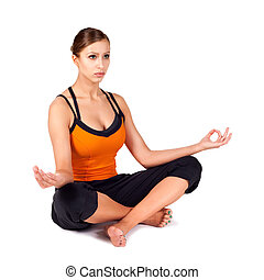 Fit Woman Practicing Sukhasana Yoga Pose - Attractive fit...