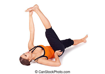 Woman Practicing Reclining Big Toe Yoga Pose - Woman doing...