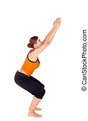 Woman Practicing Yoga Exercise Called Chair Pose - Woman...