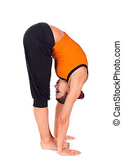 Woman Practicing Standing Forward Bend Yoga Exercise - Woman...