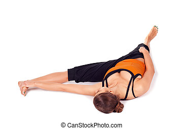 Fit Woman Practicing Reclining Big Toe Yoga Pose - Woman...