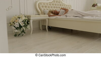 Couple sleep lying on bed morning wake up happy smile man...
