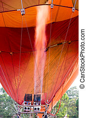 Balloon - A hot air balloon with the flame heating up the...