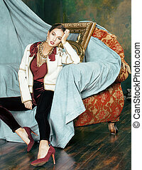 beauty rich brunette woman in luxury interior near empty...