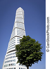 Turning Torso - The Turning Torso in Malmoe with a tree in...