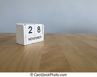 November 28th. November 28 white wooden calendar on vintage wood abstract background.Autumn day.Copyspace for text.
