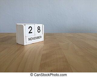 November 28th. November 28 white wooden calendar on vintage...