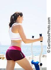 Fit woman training outdoors on a vacation - Fit and sporty...