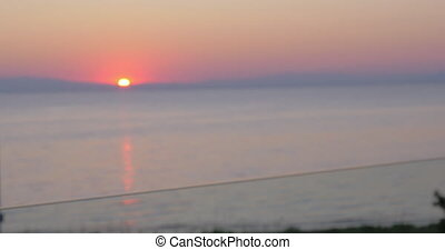 clinking glasses of champagne against sunset sea Piraeus,...