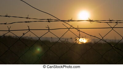 Through the barbed wire seen sea - In city of Perea, Greece...