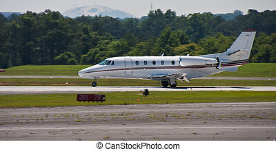 White Luxury Private Jet Touching Down