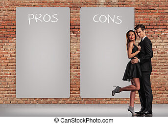 pros and cons in a relationship, young elegant couple...