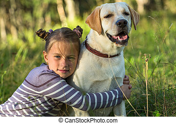 Girlie hugging her dog outdoors.