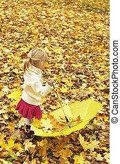 happy child playing outdoors in autumn in the park