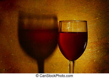 glass of red wine against textured background