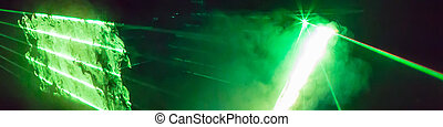Abstract panoramic background with a bright green laser rays...