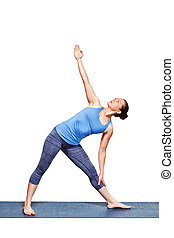 Woman doing yoga asana utthita trikonasana - extended triangle pose