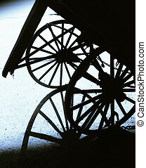 Wagon wheels - Graphic shot of two wagon wheels and shadow