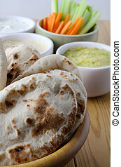 Pitta Breads with Dips Selection and Crudites on Wooden...