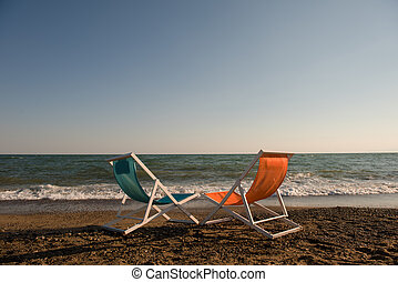 colorful beach chairs at beautiful summer day