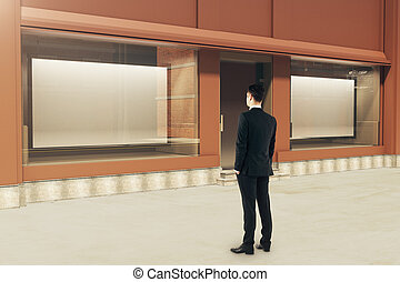 Confident man looking at showcase - Confident businessman...