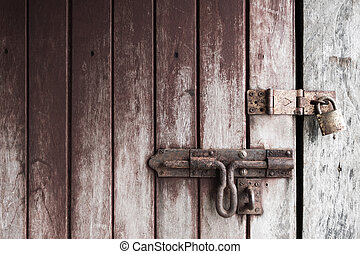 double lock - locked old wooden door with rusty padlock,...
