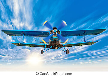 biplane - picture of a biplane in the blue sky