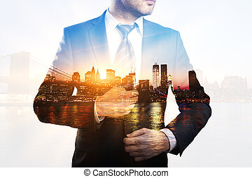 Businessman on city background multiexposure - Creative...
