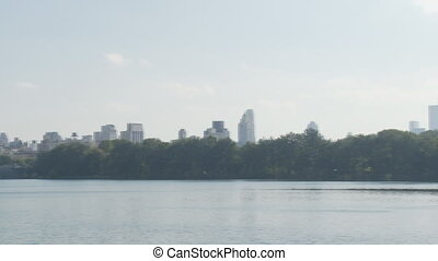 pan shot lake - pan shot over lake in central park manhattan