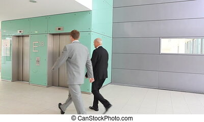 woman missing elevator TWO TAKES - two businessmen taking...