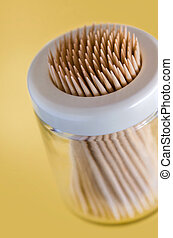 Thoothpick Box - Closeup on many wooden toothpicks in a...