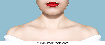Beauty woman portrait white skin and red lips closeup over blue background studio photo
