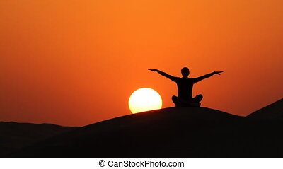 yoga sitting at sunset wider.mov