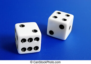 Two dice closeup on blue background