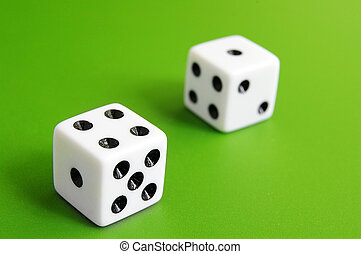 Two dice closeup on green table