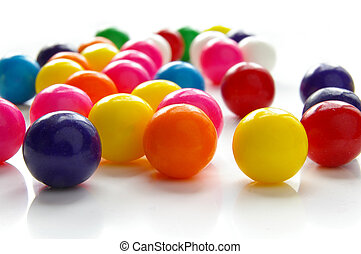 Assorted brightly colored candy gum balls on white