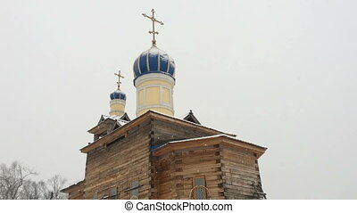Facade of a Wooden Church, Snow on Its Roofs, Forest is...