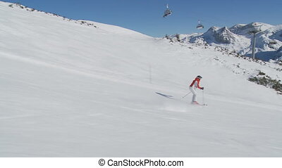 woman skiing on slope - steadicam - steadicam following...
