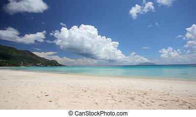 pan shot over wide tropical beach - pan shot over wide sandy...