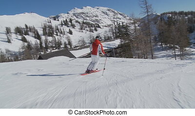 steadycam following female skier on flat piste