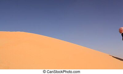 businessman with empty water bottle in desert.mov -...