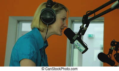 female radio moderator 2 - female radio moderator doing her...